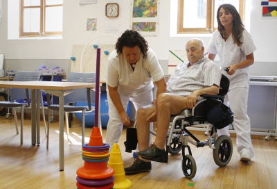 Patient who have suffered a stroke perform recovery activities with the help of nurses