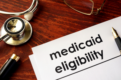 document with title medicaid eligibility on a desk