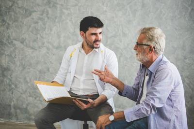 professional psychologist doctor discussing with patient in therapy sessions