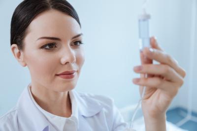 nurse setting up an IV line